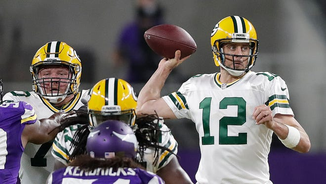 Green Bay Packers quarterback Aaron Rodgers (12) throws behind his offensive line against the Minnesota Vikings at U.S. Bank Stadium.
