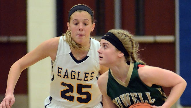 How far can Lexey Tobel (left) and the Hartland girls basketball team venture in the Class A playoffs? Or will Paige Johnson (right) and Howell be able to knock off the Eagles in districts?