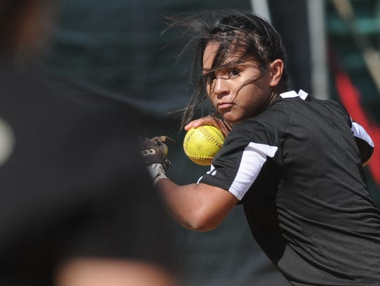 Abilene High shortstop Alyssa Washington prepares to throw to first after getting a force at second during the Lady Eagles' practice Wednesday at Abilene High School.