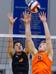 Central York's Matthew Minkin, left, leaps to block Austin Richards of Northeastern during the York-Adams League boys' volleyball championship, Tuesday, May 15, 2018. Both teams have advanced to the state 2-A semifinals. John A. Pavoncello photo