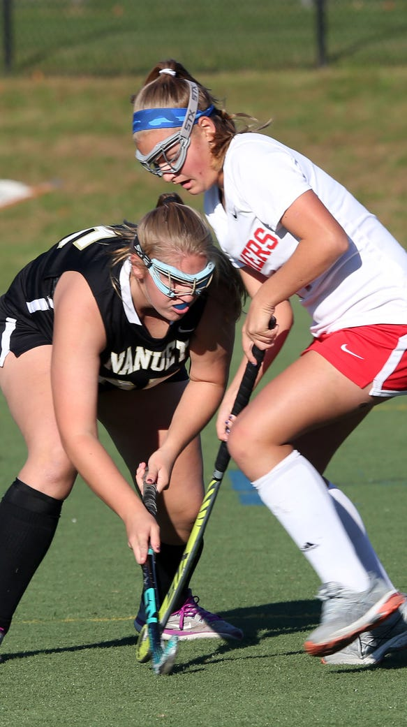 From left, Nanuet's Olivia Strohmeyer (25) and Somers