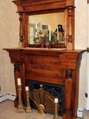 The fireplace in this Winner, S.D., home's parlor has details dating from the early 20th century. The home was built in 1914.