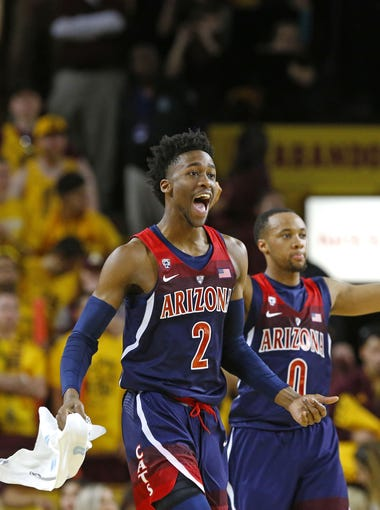 Arizona Wildcats guard Kobi Simmons (2) and guard Parker Jackson-Cartwright (0) reacts late in their 73-60 win over the Arizona State Sun Devils  in their NCAA basketball game Saturday, Mar. 4, 2017 in Tempe, Ariz.