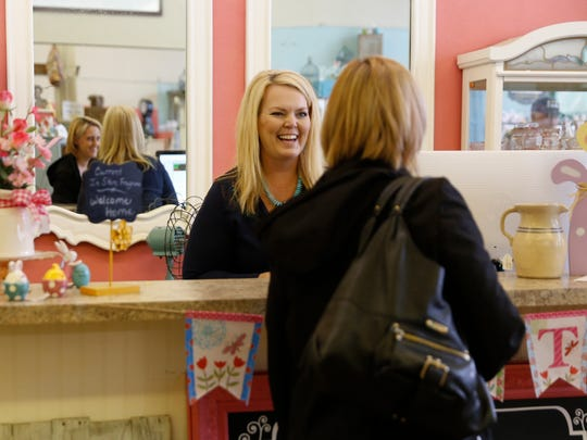 Mendie Terry, owner of A Beautiful Mess, talks with a customer at her downtown store, which closed over the weekend and will reopen next month in a new location.