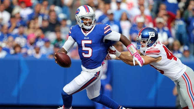 In this file photo, Bills quarterback Tyrod Taylor has to scramble in the end zone to escape Giants Craig Dahl.