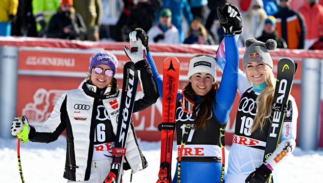 Viktoria Rebensburg of Germany takes second place, Sofia Goggia of Italy wins the race and Lindsey Vonn of USA takes third place during the Audi FIS Alpine Ski World Cup Finals  Women's Super G on March 15 in Are, Sweden.
