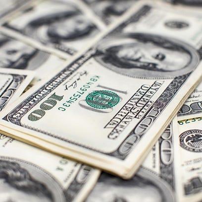 Heap of one hundred dollar bills on money background. Shallow