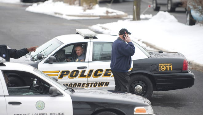 Police investigate a shooting at Shields Business Solutions in Moorestown. Monday, February 23, 2015.