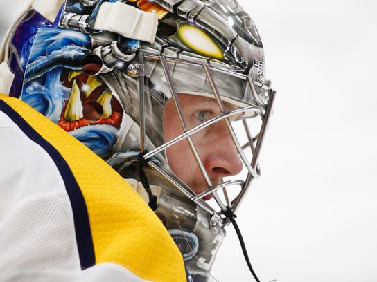 Nashville Predators goalie Pekka Rinne (35) looks on prior to an NHL hockey game against the Buffalo Sabres, Monday, March 19, 2018, in Buffalo, N.Y. (AP Photo/Jeffrey T. Barnes)