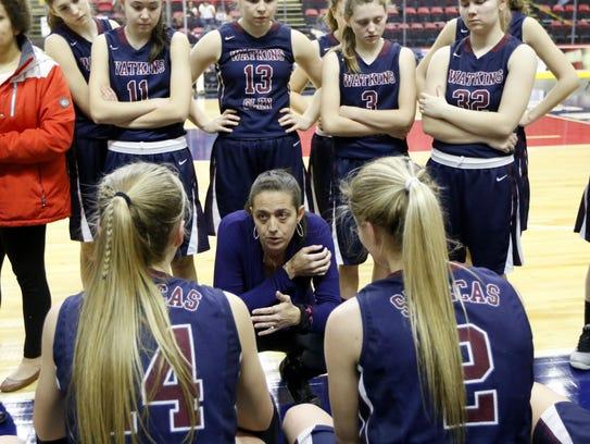 Watkins Glen head coach Alicia Learn talks to her players
