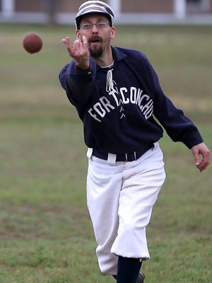 Brian Thompson slow pitches during a vintage baseball game at Fort Concho in April 2016.