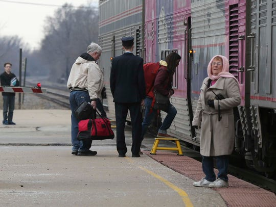 Amtrak attendant, 78-year-old Pat Green, in the pink