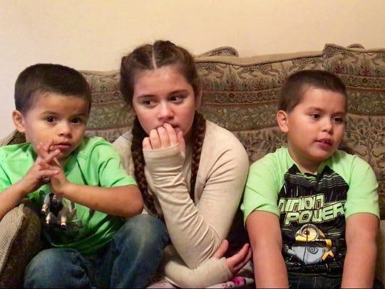 Enrique Cuahua, 5, Cecily Cuahua, 10, and Anthony Cuahua,