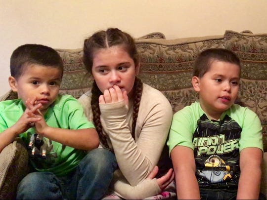 Enrique Cuahua, 5, Cecily Cuahua, 10, and Anthony Cuahua,