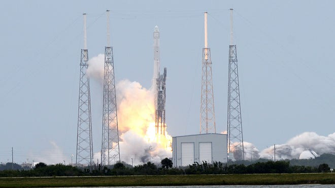 Clouds, thunderstorms and lightning anticipated Friday evening could make it difficult for SpaceX to launch a group of commercial satellites from Cape Canaveral.