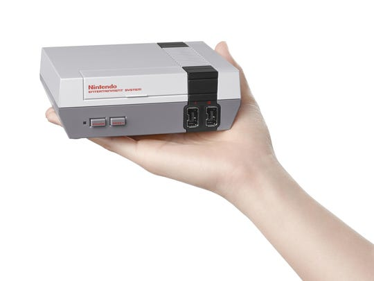 This file image provided by Nintendo shows the Nintendo Entertainment System Classic Edition. The NES Classic Edition includes all your childhood favorites, assuming you came of age in the late 1980s or 1990s.