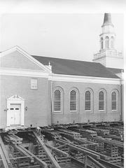 Screw jacks and Jenga-like stacks of wood beams, called cribbing, were used to raise and support Salem First Presbyterian Church while roller dollies permitted the frame to move along a track system during its move diagonally across the intersection of Chemeketa and Winter streets NE in 1958-59.