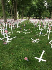 More than 150 crosses were damaged shortly before Memorial Day when a car ran through the display on the lawn in Henderson's Central Park. The more than 5,000 crosses in the display bear then name of Henderson residents who have served in the military.