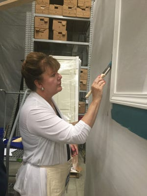 Janice Wilson tries her hand at cutting in around trim molding.