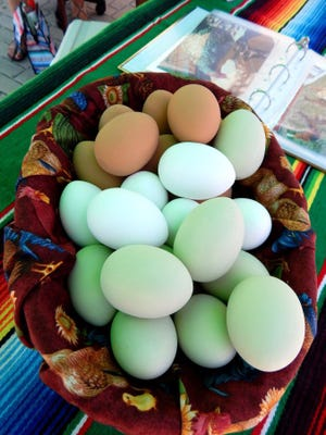 ANNE KALLAS/SPECIAL TO THE STAR At the tiny Newbury Park farmers market, fresh eggs from Carmen's Organic Eggs come from Carmen Cangas' Newbury Park backyard where she keeps a flock of about 20 different chickens.