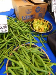 Squash blossoms, beans and squash are available at the Lore's Family Pride booth at the Newbury Park farmers market.