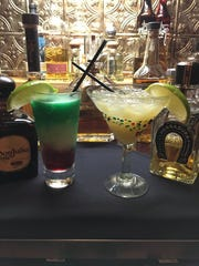 Frozen tri-colored flag margarita and the Platinum margarita from Abuelo's, 11299 Parkside Drive.