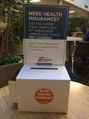 A box at CAC's L.T. Ross Building on Western Avenue invites people to get information about buying insurance through the Affordable Care Act Marketplace.