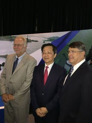 CONTRIBUTED PHOTO Port Commission vice chairman Wayne Squires (left) and commission Chairman Charles Zahn (right) pose with Xu Lirong, who heads the Cosco China Shipping Group. Cosco owns the first vessel to sail through the expanded Panama Canal.