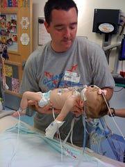 Seven years ago, Matt Pearce holds daughter Audrey