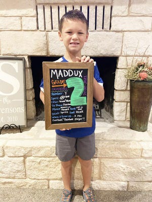 """Maddux Swenson, a 7-year-old second-grader at Chamberlin Elementary School in Stephenville, paused to pose with his own chalkboard before starting his first day of the school year Wednesday. His chalkboard shows some of his favorite things: TV show, Pokemon; movie, Dennis the Menace; book, Cat in the Hat; and food, steak. It also has a """"When I grow up"""" category, to which his answer was """"A pro football (and) baseball player."""" Maddux's parents are Justin and Karter Swenson, who posted this shot on Twitter. Justin is Stephenville High School's head baseball coach and an assistant football coach."""