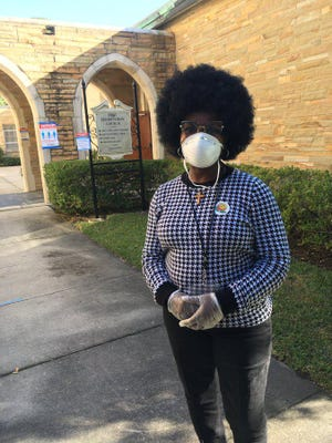 "Assistant poll manager Phyllis Beckett greeted voters outside First Presbyterian in Savannah. 'First time voter?' She called to a young man walking in with his mother. ""You can tell,"" she said."