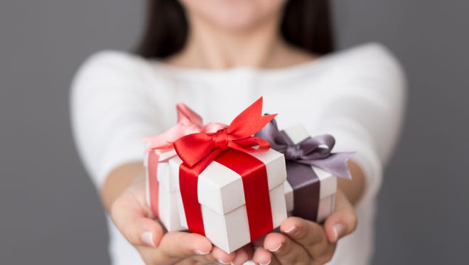 Compulsory holiday gift-giving may create more harm than good in the workplace.
