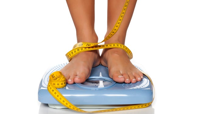Fat acquired as an adult tends to build up in the abdominal cavity. It can be reduced some via healthy eating and exercise.
