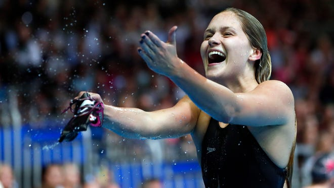 Olivia Smoliga celebrates after the women's 100 backstroke finals in the U.S. Olympic swimming team trials in Omaha on June 28.