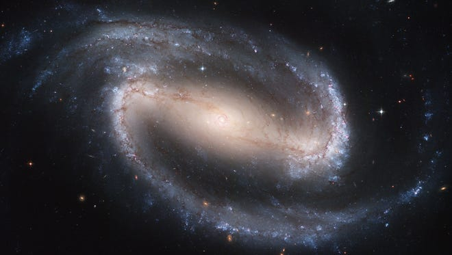 This image made by the NASA/ESA Hubble Space Telescope shows the barred spiral galaxy NGC 1300. It is considered to be prototypical of barred spiral galaxies. The Hubble Space Telescope marks its 25th anniversary. A full decade in the making, Hubble rocketed into orbit on April 24, 1990, aboard space shuttle Discovery.  (NASA/ESA, Hubble Heritage Team STScI/AURA via AP)