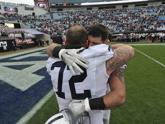Fifth-year senior Brian Gaia (72) sent off Anthony Zettel with a hug after playing his last Penn State game in the TaxSlayer Bowl. Now, Saturday will be Gaia's last home game, along with five other scholarship seniors who stayed through the Sandusky scandal, NCAA sanctions and three coaching changes. He's one of the team's unsung heroes for holding together the offensive line at center.