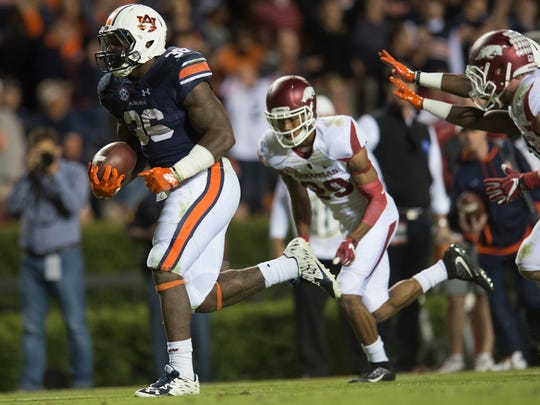 Auburn running back Kamryn Pettway (36) scores a touchdown during the NCAA football game between Auburn and Arkansas Saturday, Oct. 22, 2016, in Auburn, Ala. Auburn defeated Arkansas 56-3.