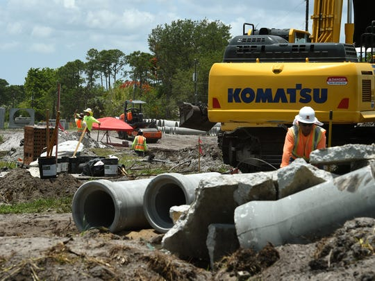 Construction is underway Wednesday, May 31, 2017, at the intersection of Southeast Floresta Drive and Southeast West Virginia Drive in Port St. Lucie. A portion of Floresta Drive will be closed from June 5 to Aug. 11 to complete necessary drainage and underground infrastructure activities for the Crosstown Parkway Project.