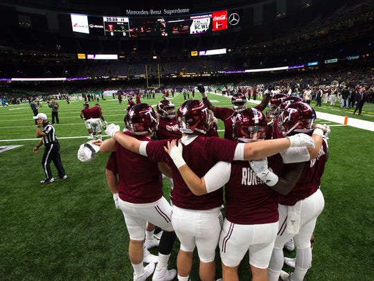 Troy players gather up before the New Orleans Bowl