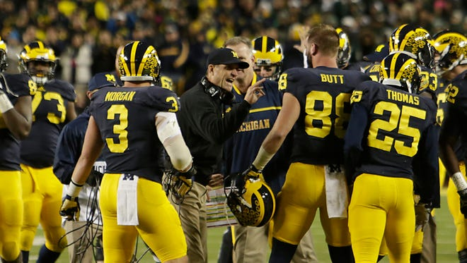 Michigan coach John Harbaugh directs his team during second-half action against Michigan State in Ann Arbor, Saturday, Oct. 17, 2015.