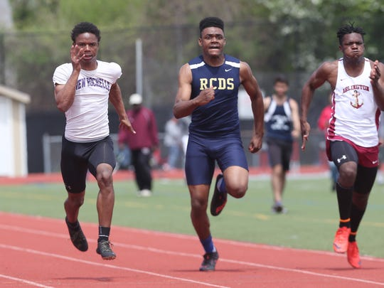 From left, New Rochelle's Jessie Parson his way to winning the boy's 100 meter during the  Somers Lions Club Joe Wynne track and field invitational at Somers High School May 5, 2018.