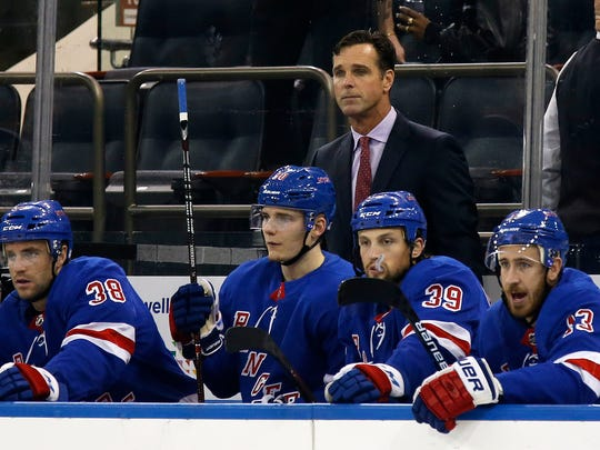 New York Rangers head coach David Quinn looks on with his players in the first period of a preseason NHL hockey game against the New Jersey Devils Monday, Sept. 24, 2018, in New York. (AP Photo/Adam Hunger)