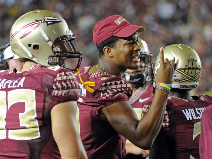 Suspended for a game against Clemson, Winston watches the Seminoles rally for an overtime win.