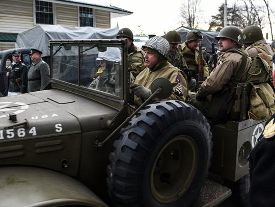A truck carrying United States Army re-enactors at