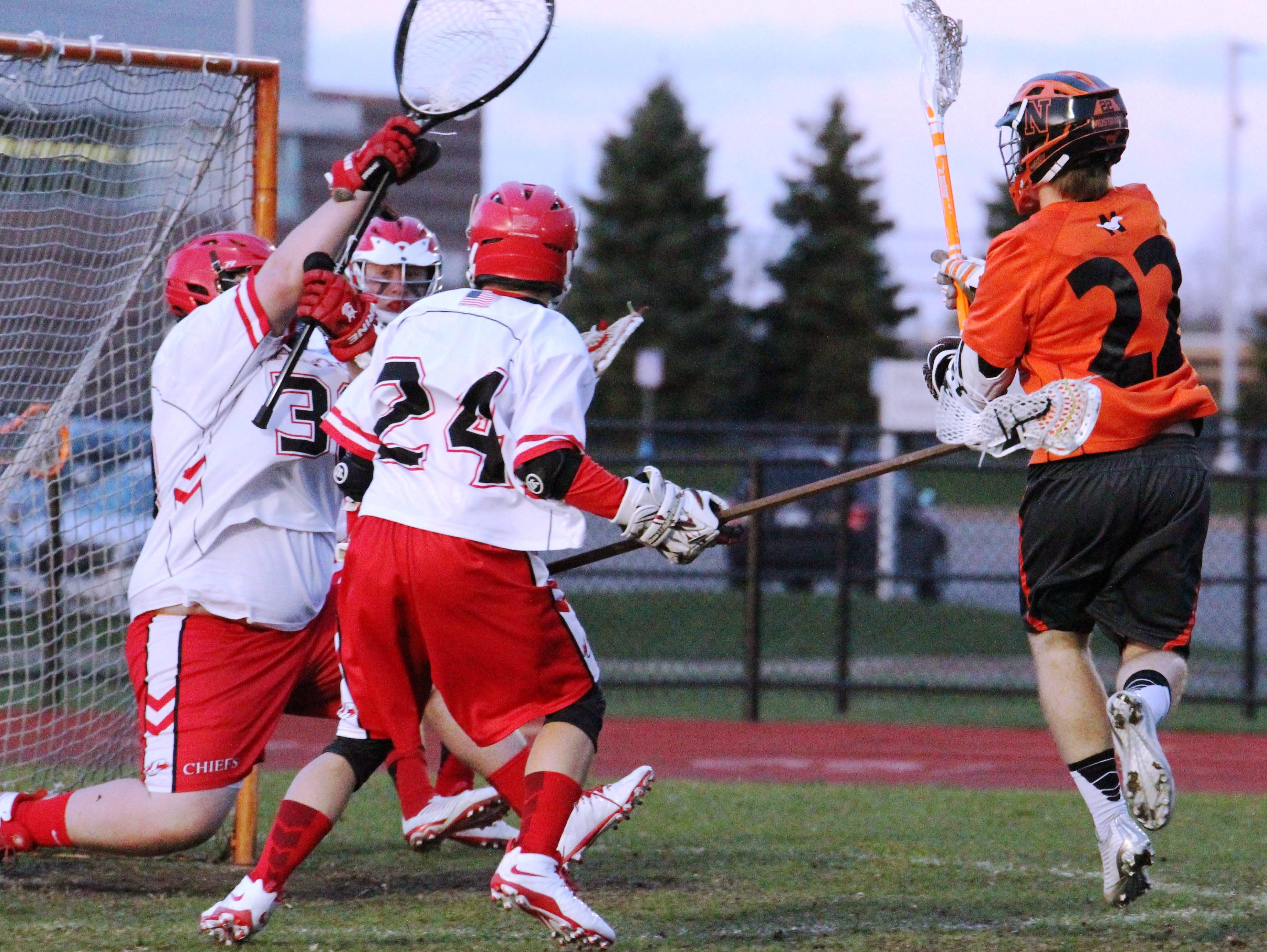 Northville's Connor Sweeney (right) takes aim at the Canton goalie in Monday's 16-4 conference win.