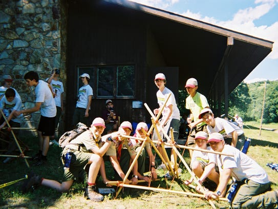 """Ben Petrzilka, kneeling far left, is shown just days before his death from a tornado June 11, 2008. His parents found it as one of two photographs in the camera he carried to Little Sioux Scout Ranch that week and have showed few people until now. But they wanted to share it now to show """"the boys having fun before we lost them forever,"""" said Arnell Petrzilka, who still wears her sons boots shown in the photo."""