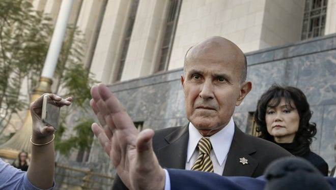 In this Feb. 10, 2016, file photo, former Los Angeles Sheriff Lee Baca leaves U.S. Court House building in Los Angeles on Wednesday, Feb. 10, 2016.