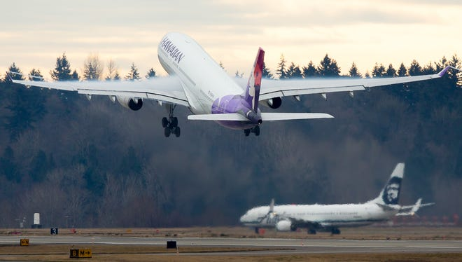 A Hawaiian Airbus A330 takes off from Seattle-Tacoma International Airport on Dec. 24, 2016.