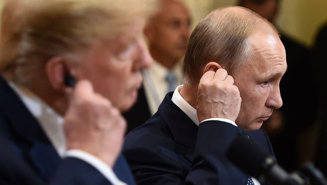 Donald Trump and Vladimir Putin attend a joint press conference after a meeting in Helsinki this week. Trump's seeming acceptance of Putin's denial of 2016 election interference -- despite  the reports of U.S. intelligence agencies -- have prompted cries of treason..