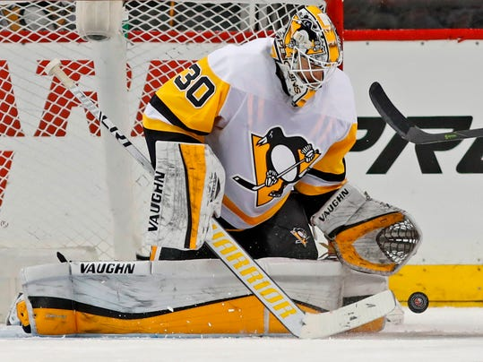 FILE - This March 20, 2018 file photo shows Pittsburgh Penguins goaltender Matt Murray (30) making a save during the third period of an NHL hockey game against the New York Islanders in New York. There are no questions anymore about who the franchise goaltender is for the Penguins. Murray heads into his third Stanley Cup playoffs firmly established as the team's top netminder. Now comes the hard part after a difficult regular season for Murray: backstopping the two-time defending Cup champions to history. (AP Photo/Kathy Willens, file)